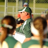 Wawasee head coach Cory Schutz makes his appeal on a call made by home plate umpire Janci Beck during the third inning of the Wawasee-Lakeland matchup at the Fairfield Softball Sectional championship.