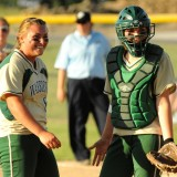 Wawasee pitcher Gabi Routson and catcher Paige Hlutke share a laugh during play at the Fairfield Softball Sectional championship.