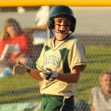 Wawasee's Kylie Norris cheers on her teammates during play against Lakeland at the Fairfield Softball Sectional.