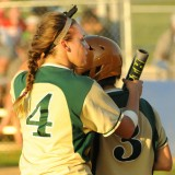 Wawasee senior Amber Yoder (4) gives advice to freshman Sam Malik (3) during play at the Fairfield Softball Sectional.