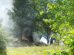 Water and foam are being used to put out a trash fire east of Warsaw. (Photo by Stacey Page)