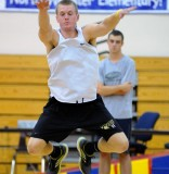 Ben Klaybor soars during the long jump at the Tournament of Champions.