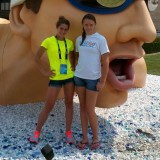 Bre Robinson, left, and Kendra Miller pose at the Olympic Swimming Time Trials village held in Omaha, NE. Robinson swam in the 200-meter backstroke on Saturday, finishing 150th overall with a time of 2:21.23. (Photo provided by Julie Robinson)