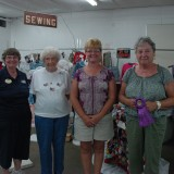 SEWING - Open class winners of the sewing division at the Kosciusko County Community Fair, from left, are Marsha Miller, Gertrude Smythe, Judy Clayton, and Pat Walters (Best of Show).