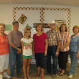 AGRICULTURE - Open class winners of the agriculture division at the Kosciusko County Community Fair, from left, are Dee Myers, Roger Studebaker, Louisa Hartel, Eileen Ransbottom, Jim Craig, Shannon McSherry, and Lily Miller (Best of Show).