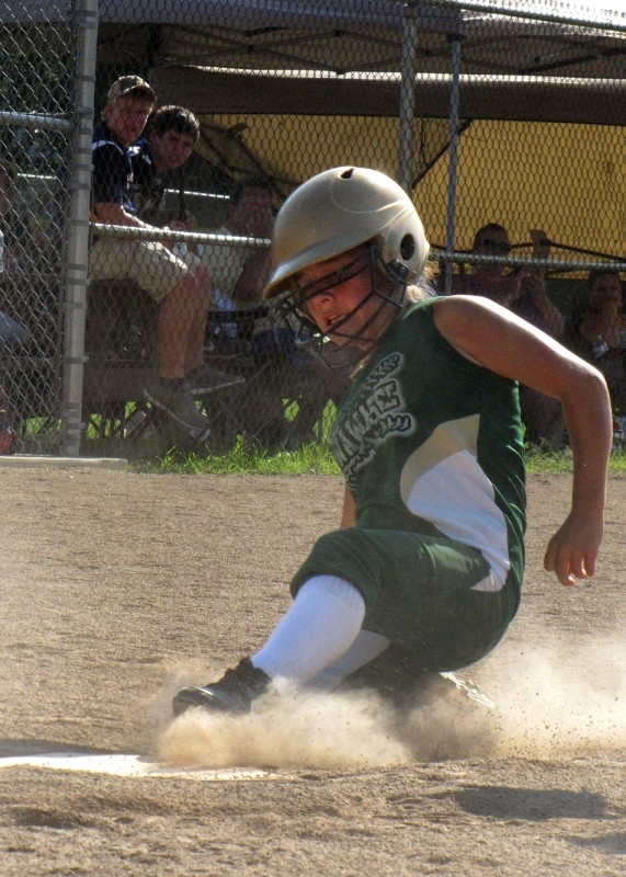 Ale Brito of the Wawasee All-Stars 12U team slides home for a run against the Indiana Mayhem at the NSA B World Series in Portage. (Photo courtesy of Amy Kuhn)