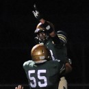 Wawasee receiver Clayton Cook celebrates with Jon Ruiz (55) after Cook caught a 31-yard touchdown pass against Warsaw.