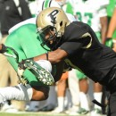 Purdue's EJ Johnson makes a tackle during a kick-off against Marshall.