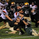 Wawasee's Maclain Herr (52) and Austin Grove (65) tackle Warsaw quarterback Jake Manges on a two-point try which decided the game.