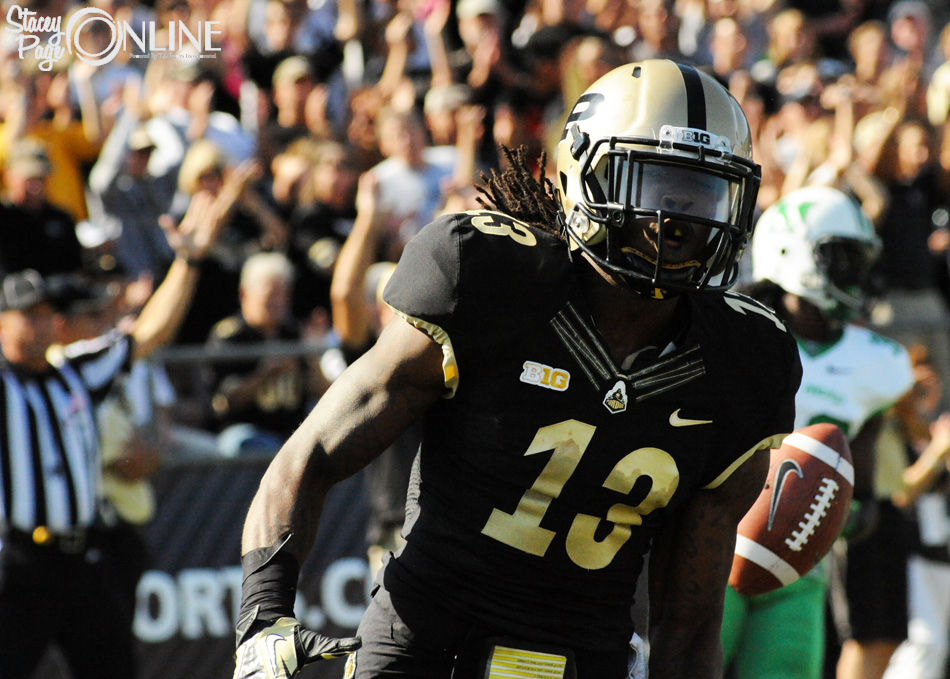 Purdue wide receiver Antavian Edison celebrates after scoring a touchdown.