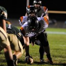 Warsaw's offense and Wawasee's defense ready themselves as Warsaw attempted a play on the goal line.