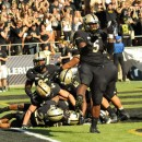 Purdue linebacker Antwon Higgs (5) joins the celebration in the endzone after John Johnson returned an interception 74 yards for a touchdown against Marshall.