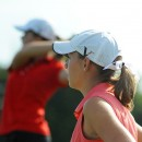 Warsaw's Elizabeth Meadows looks on as Plymouth's Lauren Rearick tees off during the Warsaw Girls Golf Sectional.