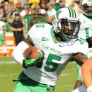 Marshall running back Remi Watson follows his blocks for a gain against Purdue.