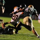 Wawasee defensive tackle Jake Schwartz (66) pulls down Warsaw running back Tristan McClone on a key fourth and goal in the first half.