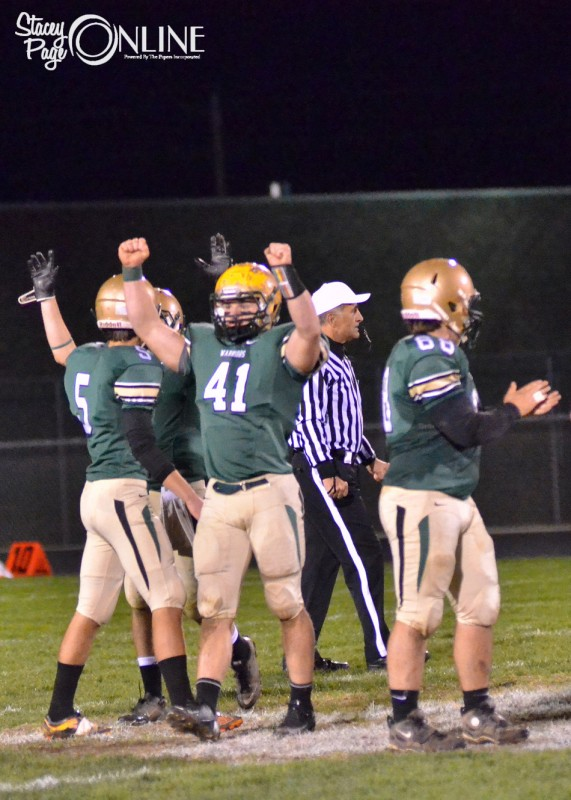 Brian Clark and his Wawasee teammates celebrate as they beat NorthWood, 31-28, in the sectional semi-final Friday night in Syracuse.