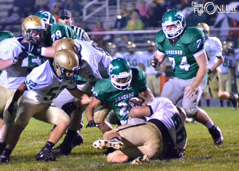 Wawasee's Jake Schwartz (66) and Maclain Herr bottle up Concord running back Jackson Marlow during the team's first matchup in September. The two teams will square off in the 4A Sectional 11 final Friday night at Concord. (Photo by Nick Goralczyk)