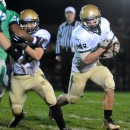 Wawasee running back Gabe Rhodes turns the corner against the Concord defense.