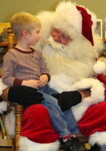 Chase Marshall chats up Santa, whom he visited with Friday in South Whitley.