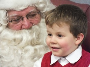 Rayven Slone enjoys his visit with Santa at the Milford Public Library on Thursday, Dec. 13. (Photo provided by Mike Ginter)