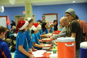 Students of Eisenhower Elementary School served the dinner hosted by Fellowship Missions Wednesday night. (Photo by Al Disbro)