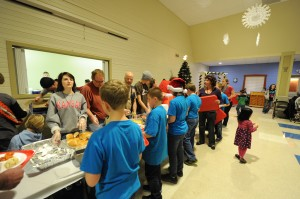 Volunteer students from Eisenhower Elementary School help served dinner Wednesday night for Fellowship Missions. (Photo by Al Disbro)