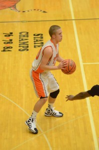 Nate Pearl of Warsaw looks for a teammate Thursday night. The junior guard scored 12 points in a Tiger win.