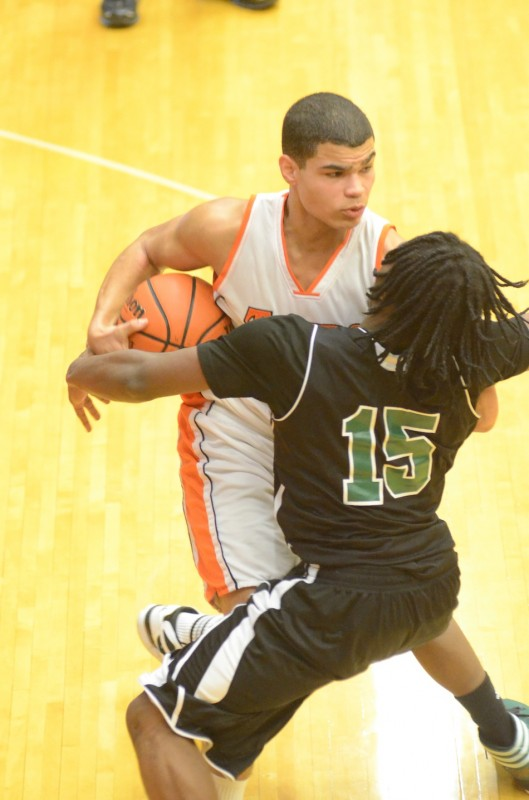 Rashaan Jackson protects the basketball from Deion Williams Thursday night. Jackson netted 10 points to help Warsaw post an 86-77 win over Fort Wayne South Side.