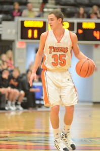 Jordan Stookey directs the show Friday night for Warsaw. The junior had 13 points in a 54-32 win over Kankakee Valley at Grace College.