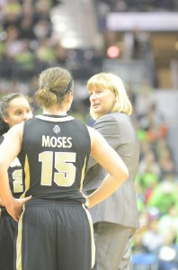Purdue coach Sharon Versyp, a former star player at Mishawaka High School, talks to Courtney Moses during a timeout Saturday at Notre Dame.