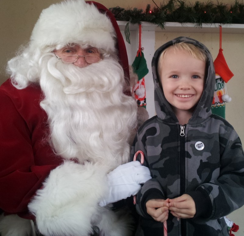 """Evan Rudd, 4, the son of Shane Rudd, was so happy to meet Santa in Rochester recently and learn that he is on the """"good boy"""" list this year."""