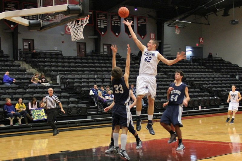 Calvin Prinsen of LCA goes in for a shot  versus South Bend Trinity in the Cougar Classic Friday at Grace College. Prinsen poured in 28 points in a 58-55 overtime win (Photo provided by Cindy Silveus)