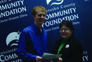 KLAS Director Dr. Nate Bosch, presents a signed fund agreement for the Kosciusko Lakes and Streams Endowment Fund to Suzie Light, executive director of the Kosciusko County Community Foundation.