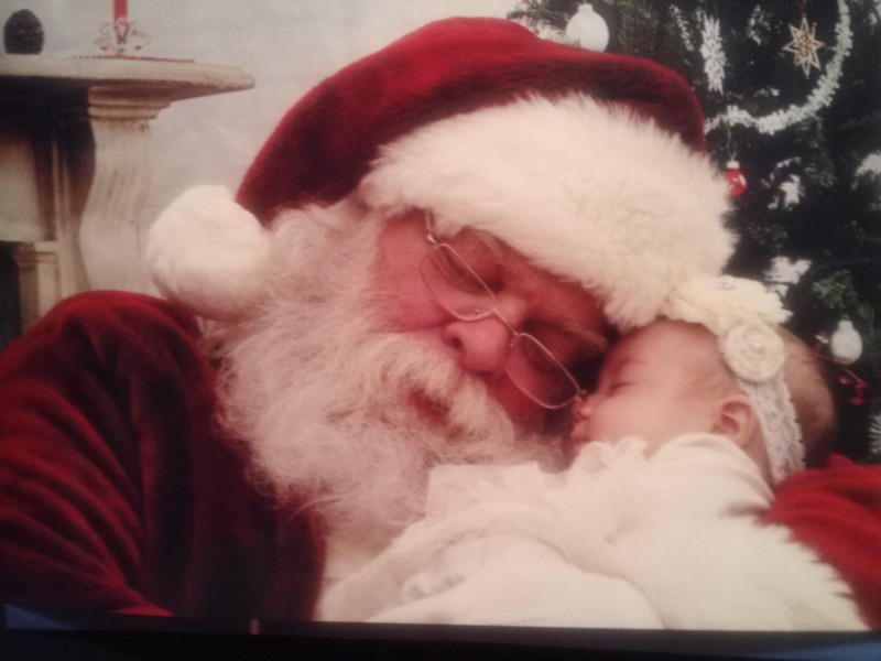 Santa catches a much needed nap with K'lynn Boger, 2 months old.