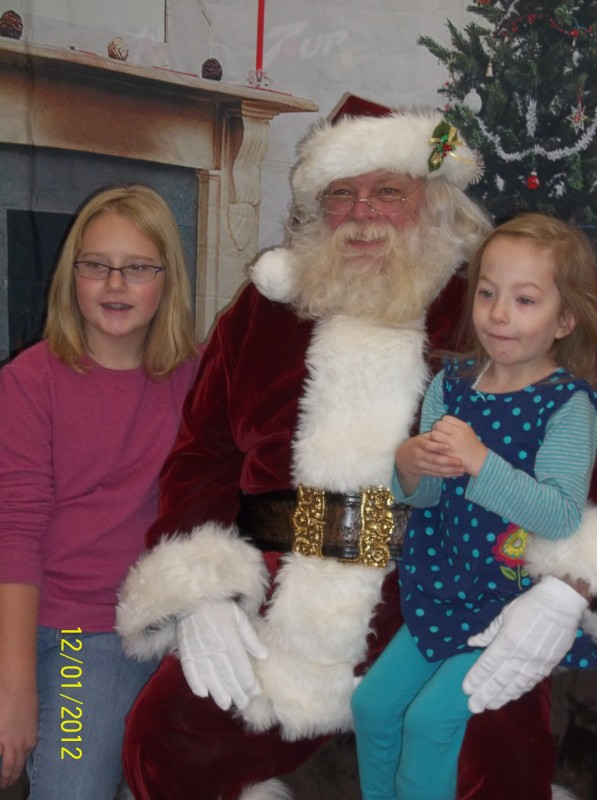 Lillie Collins, age 10, and Autumn Rogers, age 4, with Santa.