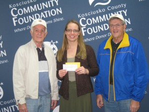 Don Morris, right, and Dan Willis, left, of the Claypool Lions Club present a donation to Stephanie Overbey for the Kosciusko County Community Foundation.
