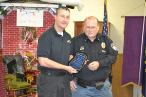 A.J. Westerman was given an Award of Valor in appreciation for his heroic efforts at the Milford Town Council meeting, because he put out a small fire at Lakeland Rehabilitation and Healthcare Dec. 1. The photo shows Town Marshal Rich Miotto, right, presenting Westerman with his award.