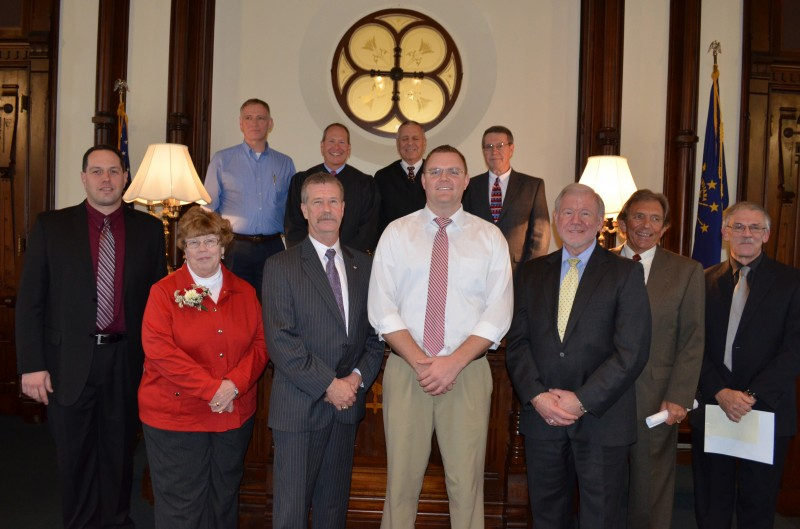 From left are county elected officials who were sworn in to office in Warsaw today: Jason McSherry, clerk of circuit court; Sue Ann Mitchell, county treasurer; Michael Wilson, coroner; Jon Fussle, county councilman at-large; Bob county councilman at-large; Larry Teghtmeyer, county council at-large; and Dick Kemper, county surveyor. In back are Brad Jackson, county commissioner northern district; Michael W. Reed, circuit court judge; Rex Reed, outdoing circuit court judge; and Ron Truex, county commissioner middle district.