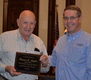 Long-time Kosciusko County Councilman John Anglin, left, was presented with a plaque for his years of service by Kosciusko County Comissioner Ron Truex. (Photo by Stacey Page)