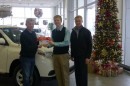 Dr. Nate Bosch, director of Kosciusko Lakes and Streams at Grace College, pictured in the center, is presented a check by Dave Illingworth, left, president of Toyota of Warsaw, and John Rice, general manager of Toyota of Warsaw. (Photo provided)