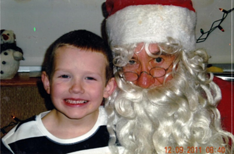 """For such a young child, Travis Prater, 7, has had much sorrow in his life, including open heart surgery and absent close family members. """"It is so special to see his delight in visiting with Santa,"""" write Cindy Shelton, who submitted Travis' picture."""