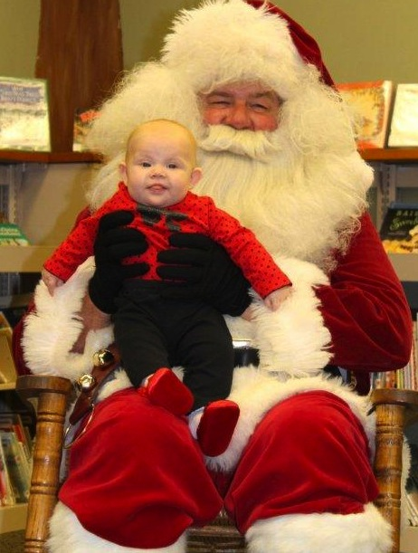 Aubri Jefferson, 5 months, met Santa for the first time Friday night, Dec. 14, at the South Whitley Public Library. She is the daughter of Jill Yagel and Shane Jefferson.