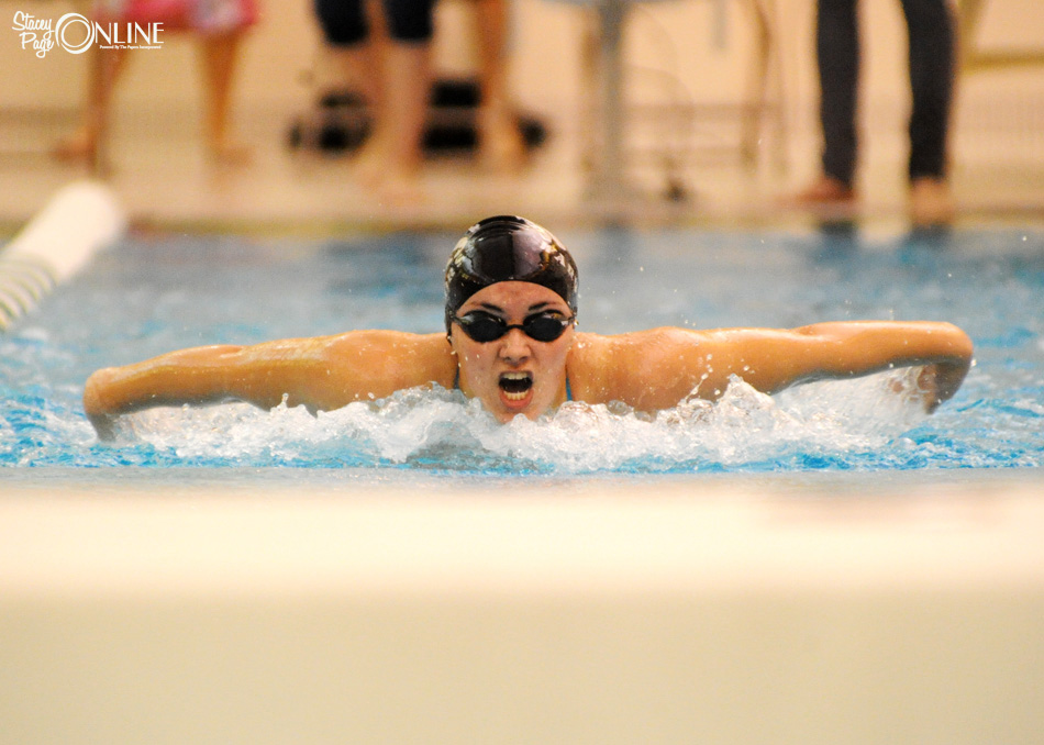 Caitlin Clevenger swims the butterfly at Northridge.