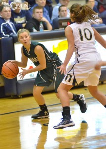 Wawasee's Natalie Jones looks for a passing lane around Norwell's Laken Chaney.
