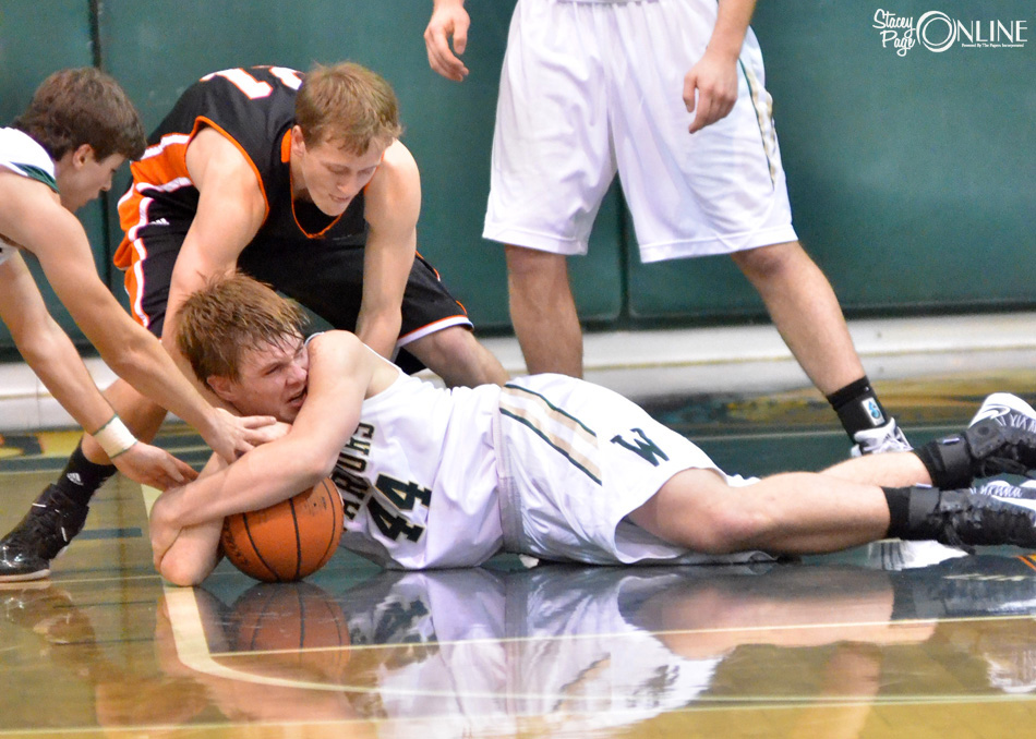 Wawasee's Chase Rookstool battles for possession with Warsaw's Jason Ferguson Friday night. (Photos by Nick Goralczyk)