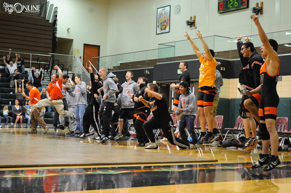 Warsaw's bench erupts in celebration after Luis Cervantes scored a pin to give the Tigers a 36-35 victory over Wawasee. (Photos by Mike Deak)