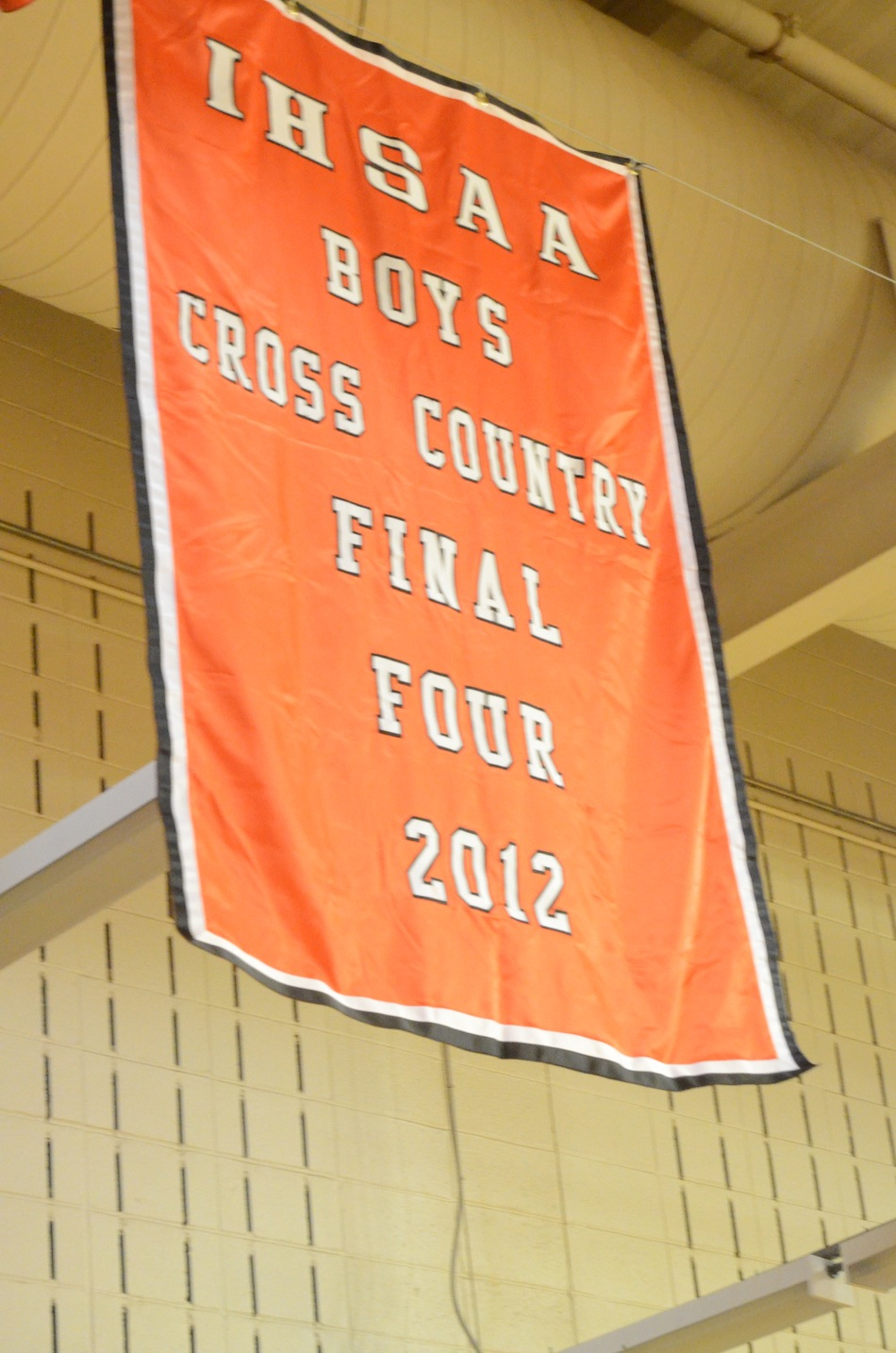 A banner honoring the outstanding season by the Warsaw boys cross country team this past fall flies in the Tiger Den after being unfurled Friday night.