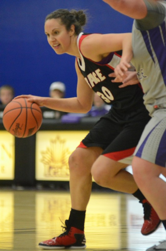Grace's Allison Kauffman makes a move at Goshen College Saturday. The sophomore had 16 points and 10 rebounds in a 78-69 win.