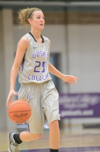 Goshen College senior Paige Davis, who played at Triton High School, brings the ball up the court Saturday.