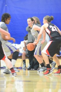 Jaime Stack, a former standout at Fairfield High School, looks for room Saturday. The Goshen College sophomore had nine points.